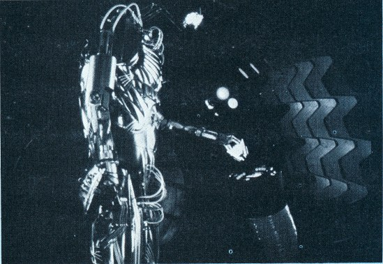 Hector reenters the decontamination chamber after stranding Adam outside (deleted scene).