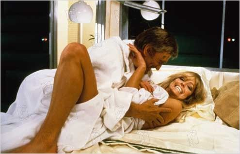 Kirk and Farrah share a joke on the set. (publicity still)