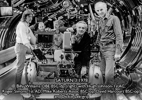 The Saturn 3 camera crew pose on a custom built wheeled camera rig used for fast-moving dolly shots shots. DOP Billie Williams BSC would later go on to win an Oscar for Gandhi.