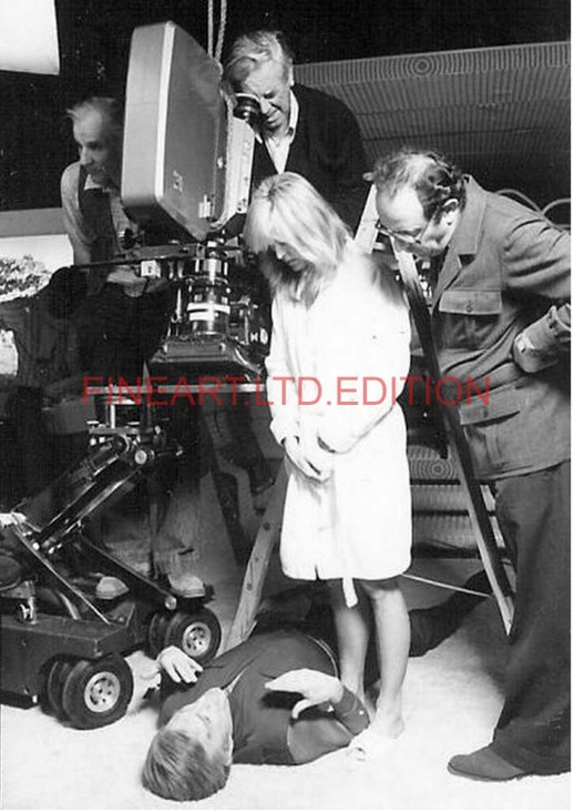 Stanley Donen stands next to Farrah while camera operator David Harcourt films a close up of Kirk on the living quarters set.