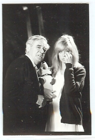 Camera operator David Harcourt BSC confers with Farrah who is holding a toy dog as a lighting stand in for the real dog Sally. Note that Farrah is wearing a cardigan - must get cold on Saturn 3.